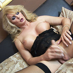 Mature blonde tranny babe jerking her cock.