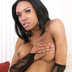 Gorgeous black shemale playing with anal beads.